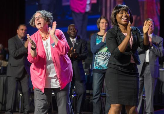 The Rev. Debra Tyree (left) and Sylvie Ndjungu help lead morning worship at the 2016 United Methodist General Conference.