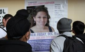 Students at Amanda's high school view a poster featuring her portrait, which promotes an anti-bullying campaign.