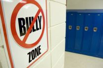 No bullying zone sign in school hallway. Photo by iStockphoto/Patrick Herrera.