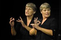 Betty Ostrom provides American Sign Language interpretation at the 2012 United Methodist General Conference in Tampa, Florida. A double exposure for United Methodist News Service by Paul Jeffrey.