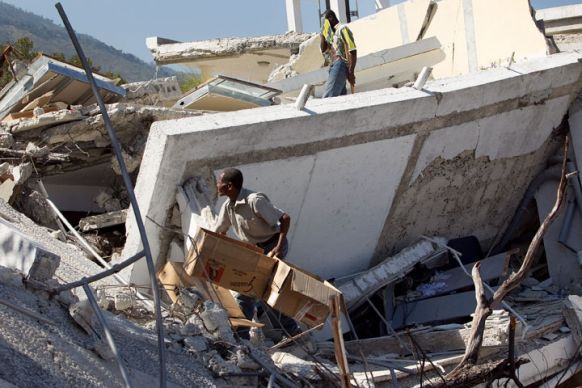 Workers dig through the rubble of the Hotel Montana in Port-au-Prince.
