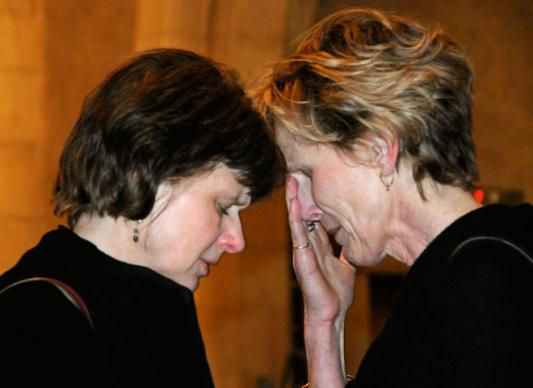 The Rev. Suzanne Field Rabb (left) and Cindy Dixon share a moment following a memorial service for the Revs. Clinton Rabb and Sam Dixon at The Riverside Church in New York.
