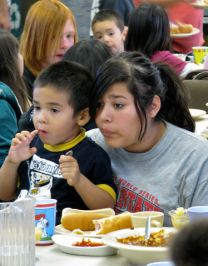 Children and their families enjoy a free meal at Wesley United Methodist Church in Fresno, Calif. Photo by Barry Simmons.