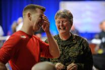 The Rev. Laura Bender, a United Methodist Navy chaplain and  regimental chaplain for Wounded Warriors, shares a moment of laughter with Lance Cpl. Damaso Soto. A UMNS photos by Jay Mallin.
