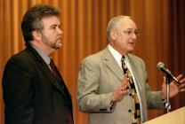 Oyvind Helliesen (left) and Daniel K. Church present the