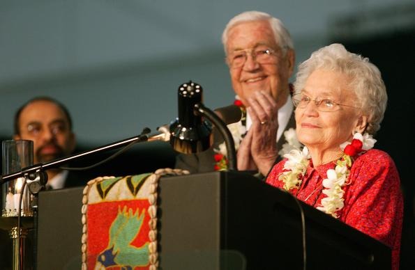 Eunice Mathews (right) is honored by the United Methodist Church's 2004 General Conference in Pittsburgh for a lifetime of service to the church. The tribute comes on her 90th birthday. Among the thousands applauding her is her husband, Bishop James, K. Mathews. A UMNS photo by Mike DuBose.