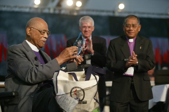 Bishop James S. Thomas (left) is honored by General Conference for the contributions he made dismantling the former Central Jurisdiction of the church. A UMNS photo by Mike DuBose.
