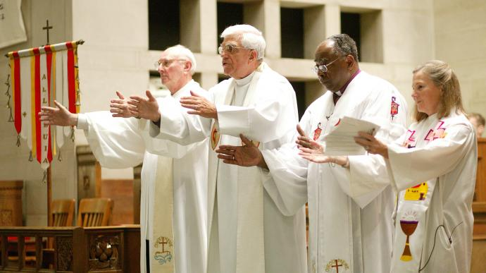 United Methodist Bishops (from left) Richard Wilke, George Bashore, William Morris and Mary Ann Swenson offer a symbolic benediction during a worship service of