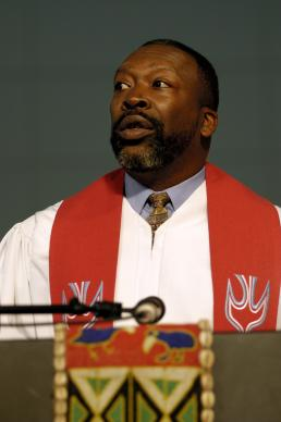 The Rev. Vincent Harris reads scripture during a service of