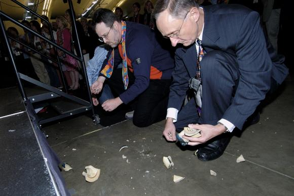 Bishop Donald A. Ott (right) picks up pieces of a communion chalice intentionally broken during a protest after delegates to the 2004 United Methodist General Conference in Pittsburgh maintained language in the church's Book of Discipline that the practice of homosexuality is
