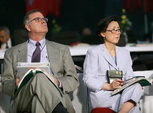 The Rev. Larry Hollon and the Rev. Sung-Ja Lee Moon watch as General Conference approves Igniting Ministry. A UMNS photo by Mike DuBose.