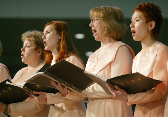 The Mytischi United Methodist Church choir from Moscow sings during morning worship on May 6 at the denomination's 2004 General Conference in Pittsburgh. A UMNS photo by Mike DuBose.