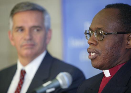 Rev. Benjamin Boni (right) and Rev. R. Randy Day announce that the million-member Protestant Methodist Church of Cote d'Ivoire is joining the United Methodist Church during a press conference at the United Methodist Church's 2004 General Conference in Pittsburgh. Boni is leader of the Cote d'Ivoire delegation to General Conference. Day is top staff executive of the United Methodist Board of Global Ministries. A UMNS photo by Mike DuBose.