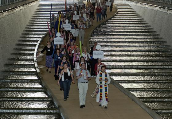 Members of Methodist Students for an All-Inclusive Church (MOSAIC) march to the Allegheny River through the David L. Lawrence Convention Centerin Pittsburgh, site of the 2004 United Methodist General Conference. The group is pushing the denomination to fully accept gays and lesbians in its churches and pulpits. At the end of the march it held a service of renewing the baptismal covenant on the banks of the Allegheny River. A UMNS photo by Paul Jeffrey.