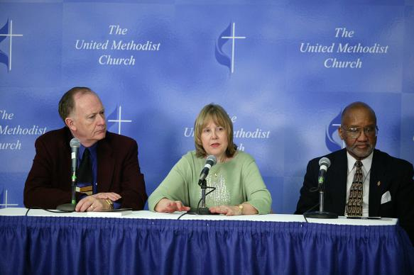 Don Messer, Linda Bales (GBCS) and Bishop Felton May at an AIDS press conference during General Conference 2004. A UMNS photo by Mike DuBose