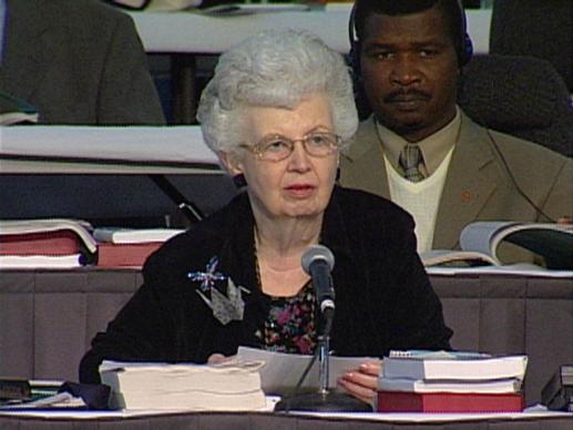 General Conference 2004: Carolyn Marshall reads decision #985. Video still by United Methodist Communications