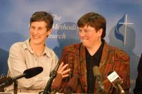 The Rev. Karen Dammann (right) and her partner, Meredith Savage, share a light-hearted moment at a news conference following Dammann's clergy trial. A trial court of 13 pastors acquitted Dammann of charges that could have resulted in the loss of her ministerial orders. A UMNS photo by Les Fetchko.