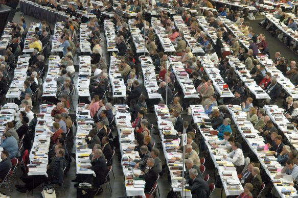Delegates to the United Methodist Church's 2004 General Conference consider legislation from  their seats in the David L. Lawrence Convention Center in Pittsburgh.