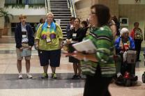 A quiet demonstration in support of full inclusion of gays and lesbians in the life of The United Methodist Church occurs as delegates and visitors leave the April 26 plenary session of the 2012 General Conference in Tampa, Fla.