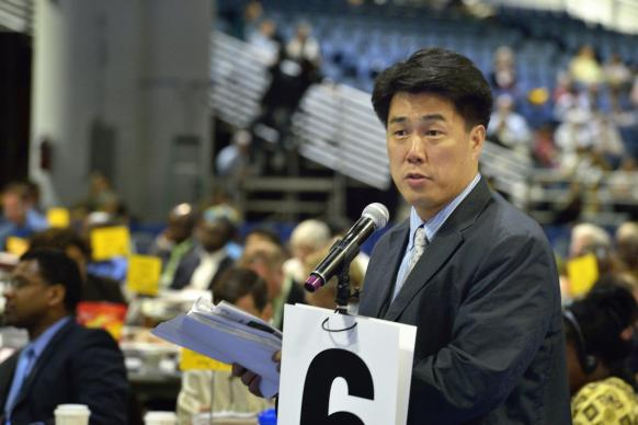 The Rev. We Hyun Chang, a pastor in Belmont, Mass., and a delegate from the New England Annual (regional) Conference, argues to reconsider retaining guaranteed appointments for clergy, during a debate at the 2012 United Methodist General Conference in Tampa, Fla. The guarantee of an annual appointment for elders was eliminated by the conference on May 1.