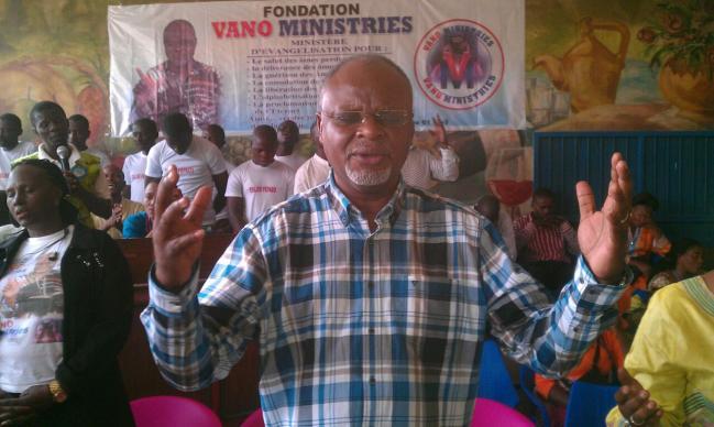 Vano Kalembe Kiboko, a United Methodist lay evangelist, prays in civilian prison in the Democratic Republic of Congo. He led hundreds of people to Christ while in prison himself. UMNS photo courtesy of the Rev. Kiboko I. Kiboko.