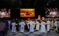 Four bishops, surrounded by deacons, celebrate the Great Thanksgiving at the opening communion worship at the United Methodist 2016 General Conference in Portland, Ore. Photo by Maile Bradfield, UMNS.