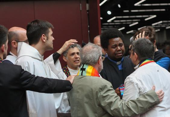 Activists support each other following a silent march through the May 18 plenary session of the 2016 United Methodist General Conference in Portland, Ore. They are protesting what they believe is an attempt to silence LGBTQ voices. Photo by Maile Bradfield, UMNS.