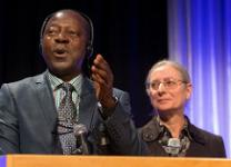 Stanislas Kassongo (left), a delegate from Central Congo, takes part in a panel discussion during the Pre-General Conference Briefing in Portland, Ore. Isabelle Berger (right) is a French interpreter from the denomination's Board of Global Ministries. Photo by Mike DuBose, UMNS.