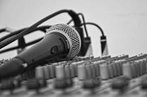 Image shows microphone and sound board. Courtesy of pexels.com.