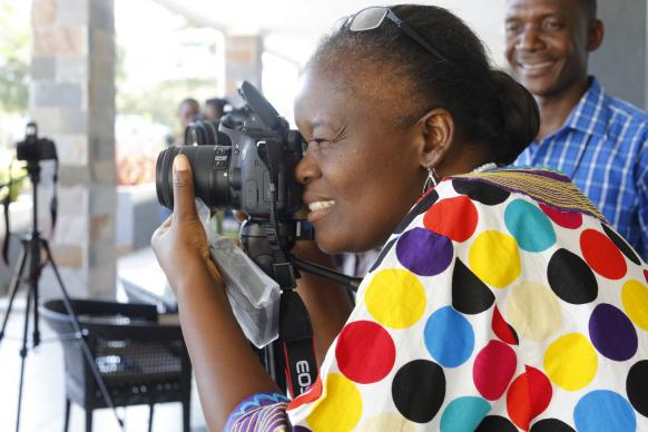 Betty Kazadi Musau focuses her camera during training for communicators from the Congo Central Conference. United Methodist Communications held the training Nov. 12-17 in Ndola, Zambia. Photo by Kathleen Barry, UMNS.