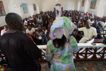 Sierra Leone Conference lay leader, Anne Koroma (right), addresses Trebes Memorial United Methodist Church in Bo, Sierra Leone, on the roles of lay leaders in local churches. Associate lay leader, Dr. Victor Massaquoi, stands to the left of Koroma. Photo by Phileas Jusu, UMNS.