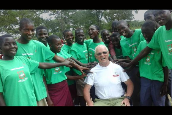 Dave Bonney, a member of Smithville United Methodist Church in Dunkirk, Maryland, poses with students from the Hanwa Secondary School in Macheke, Zimbabwe. In March of 2016, Bonney visited the school to help set up a program called Helping Others Help Others to improve scholastic achievement at the small, rural school. Photo courtesy of Dave Bonney.