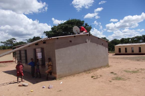 A satellite dish was installed on the roof of Hanwa Secondary School in Macheke, Zimbabwe to receive data available on the Internet, such as classic books, text books and Wikipedia, via Outernet transmissions. The Outernet program was featured at United Methodist Communications' Game Changers Summit 2015. Photo courtesy of Dave Bonney.