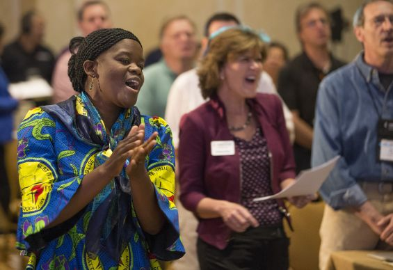 The Revs. Betty Kazadi Musau (left), of the Democratic Republic of Congo, and Neelley Hicks sing during opening worship at the Game Changers Summit at the Opryland Hotel in Nashville, Tenn. Photo by Mike DuBose, UMNS.