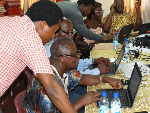 District superintendents attend a two-day training in Freetown in basic computer skills Sept. 8, 2016. The training, organized by John Yambasu (left), was to equip the superintendents to use laptops donated by United Methodist Communications upon their return to their districts. Photo courtesty of Phileas Jusu, United Methodist Communications