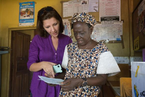 Maeghan Orton (left) learns about how medical records are kept at the United Methodist Church's Mercy Hospital in Bo Sierra Leone, from Taiwo Sesay, who oversees the hospital's maternity unit. Orton is from Medic Mobile, a technology partner of United Methodist Communications. Photo by Mike DuBose, UMNS.