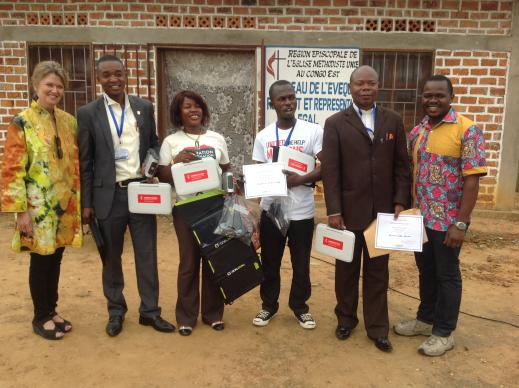 The Rev. Neelley Hicks, director of United Methodist Communications' ICT4D initiative (left), and Pierre Omadjela, special projects manager for United Methodist Communications (right), pose with UMConnect grant recipients. Photo courtesy of Pierre Omadjela.