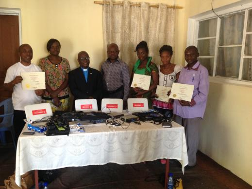 UMConnect grant recipients show off their training certificates and the new hardware they will use to set up the UMConnect system in their respective communities. Photo courtesy of Pierre Omadjela.