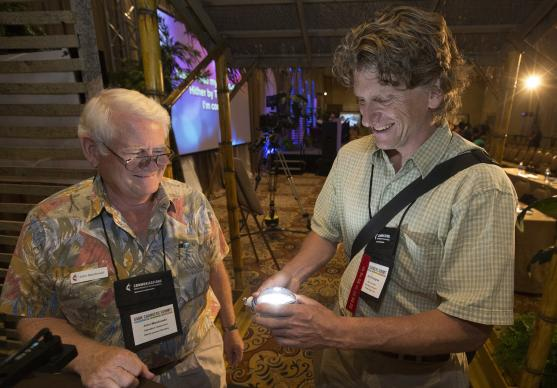 Eric Youngren (right) and John Macdonald view a solar-powered light during the Innovation Fair at the Game Changers Summit at the Opryland Hotel in Nashville, Tenn. Photo by Mike DuBose, UMNS.