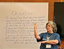 Mary Harris, who leads a ministry for the deaf at Conway UMC, Orlando, demonstrates sign language communication at a Mission u workshop.  Photo by Susan Green, UMW.