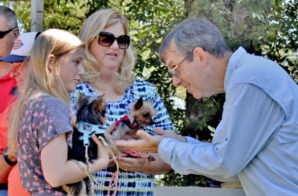 The Rev. Brad Slaten, far right, of First United Methodist Church, Coleman, Texas, is pictured here during a Blessing of the Animals Service. His sermons, members say, are not too short and not too long, but are just the right length. Photo courtesy of the Central Texas Conference.