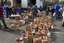 Boy scouts in Charlotte, NC load food donations into trucks as part of the food drive during the Super Bowl weekend. Photo courtesy of the Western North Carolina Conference.