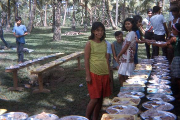 Participants prepare food before a meal at Christmas Institute 1969 in Mindoro, Philippines. Photo courtesy of Mary Helen Marigza.