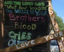 Image of sign at protest reacting to death of Michael Brown in Ferguson, Mo.  Courtesy of United Methodist General Commission on Religion and Race.