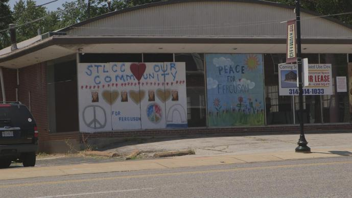 Businesses in downtown Ferguson, Missouri display messages of hope one year after protests filled the streets here.