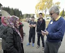 Pastor Rolf Held talks about how United Methodist church members in Germany have welcomed refugees fleeing war-torn countries. Image from video by UMCOR.