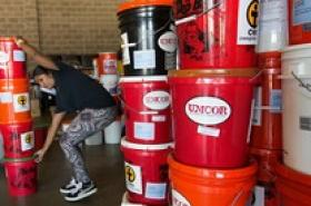 Flood buckets from UMCOR help after storms. File image by Mike DuBose.