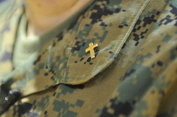 A cross pin reflects Cmdr. Laura Bender's service to the military. Photo by Jay Malin, UMNS