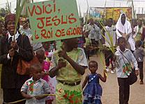 Crowds wave palm branches and signs written in French in Port-Bouëtt on Palm Sunday. United Methodist Communications recently launched a French language version of its web portal. Photo by Isaac Broune, United Methodist Communications.