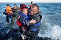 Nabil Minas, a refugee from Syria, carries his children to the shore of the Greek island of Lesbos.